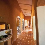 Even the passage that connects the various sections of the house enjoys the drama of the outdoors and is one with nature. The beautiful terracotta tiles on the floor add a lot of character.