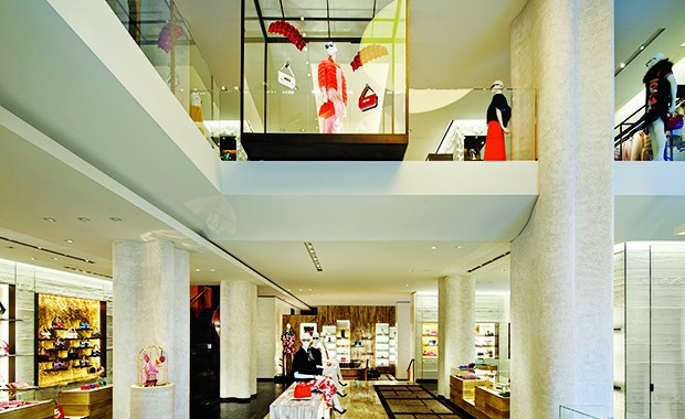A view of the interior boutique facade with a flooring combination of marble and Indonesian wood. Bags, shoes and glares are displayed on the ground level while fur coats, clothes and watches are part of the first floor layout.