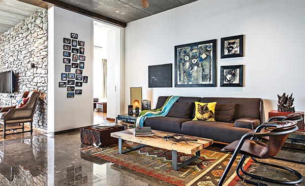 The casual seating area of the living room. The picture wall captures moments with family, friends and while travelling. The art wall juxtaposes work by one of Hameeda's favourite artist and paintings done and gifted by family.