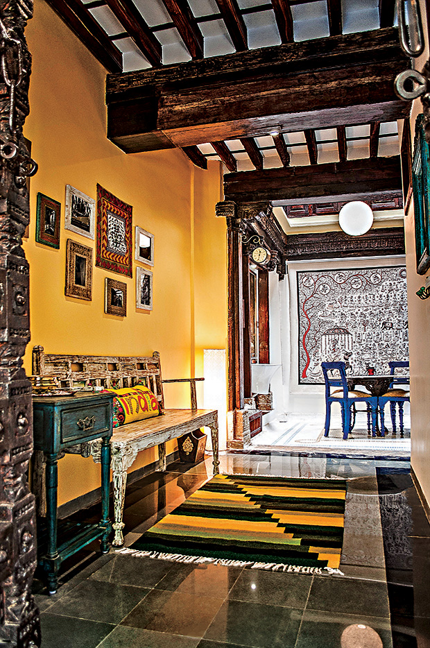 The entrance lounge is adorned with quirky photographs of the original derelict haveli that narrate its transformation.  The warm colours and alluring patterns of the centrally placed Chakado (traditional Gujarati handmade woven painting on cloth), completes the look.