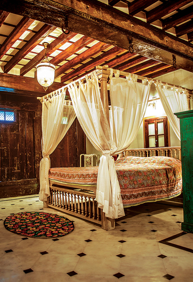 For the bedroom on the first floor, a custom-designed bed is configured from the residual timber columns and beams with the headboard and footboard made from discarded wooden railings.