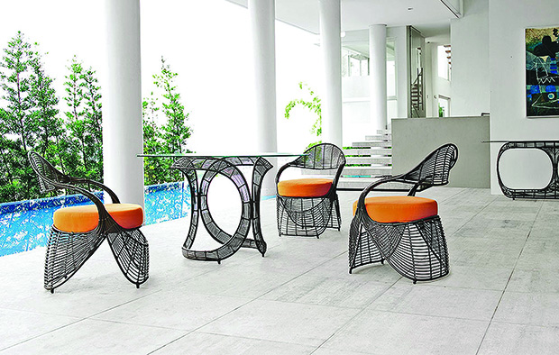 The Manolo range of outdoor furniture with Idus is inspired by the curves of a lady's sandals.  It is made of synthetic rattan vines over a steel frame and bound with rattan strips.