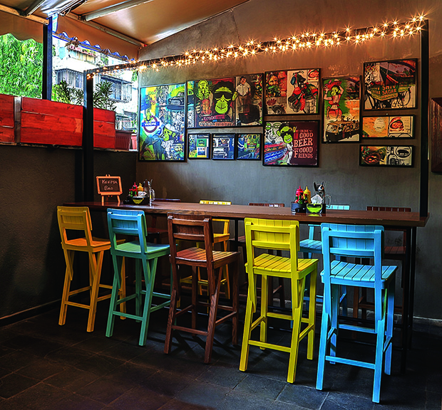 The same quirky thread of the interiors is carried over to the outside seating with high bar chairs and monkey graphics.